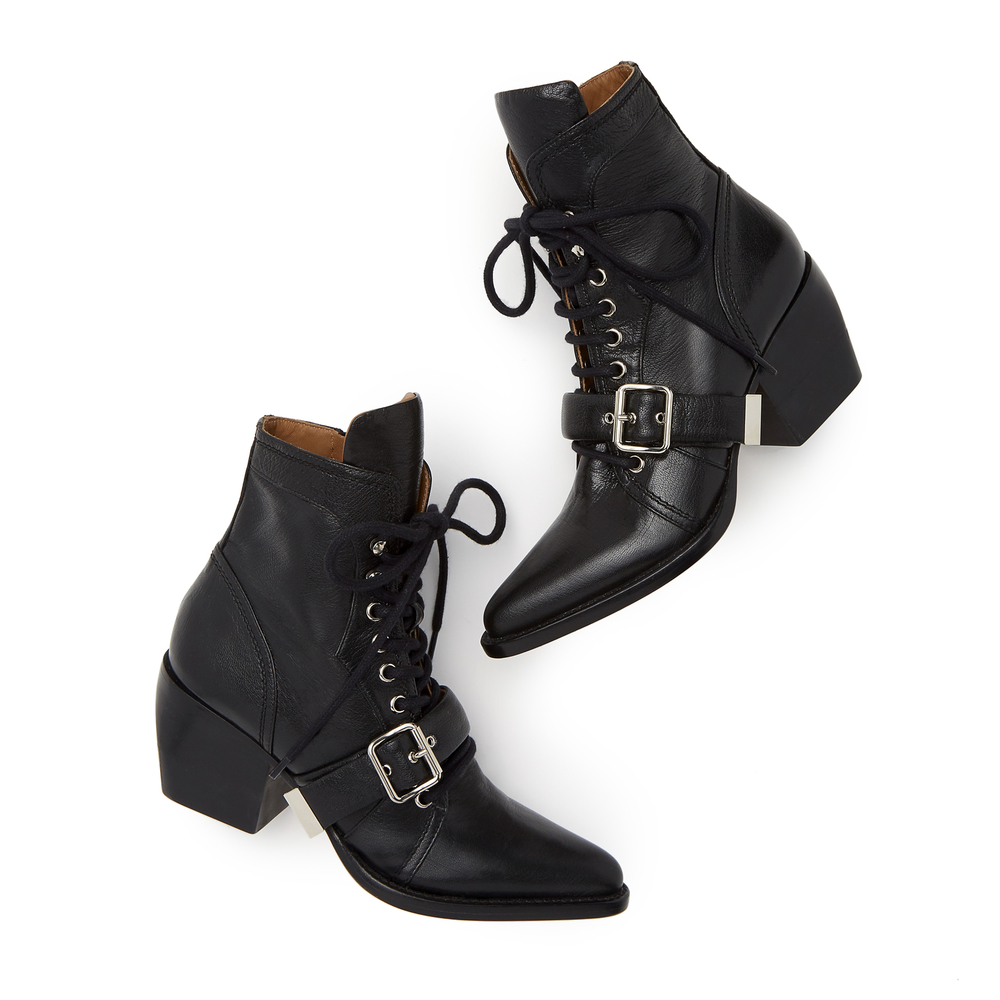 Chloé Lace-Up Heeled Booties in Black, Size IT 38 Chloé Lace-Up Heeled Booties in Black, Size IT 38: This season, Chloé took a Western approach to the combat boot. Made in Italy from polished black leather, this crossover style features a sleek pointed toe, a lace-up front, and side zippers for easy coming and going.(Honorable mention to the extremely walkable heel.) Wear them with florals, ruffles, and anything else that needs a little edge. Calf and goat leather Made in Italy.